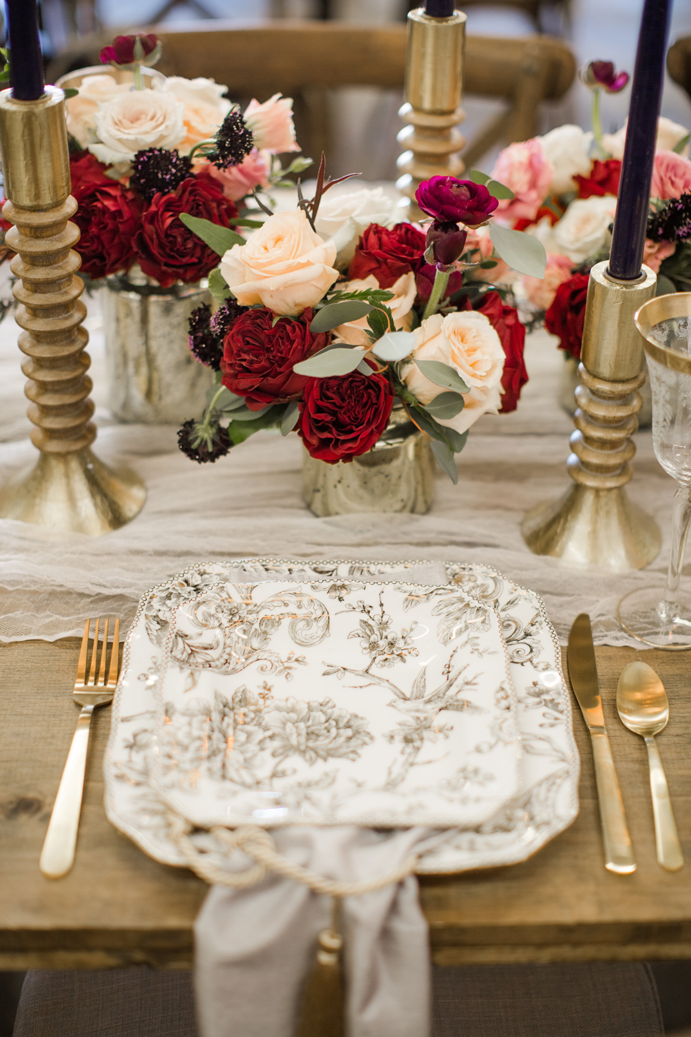vintage inspired place settings - photo by Laura Wick Photography http://ruffledblog.com/elegant-parisian-inspired-wedding-ideas
