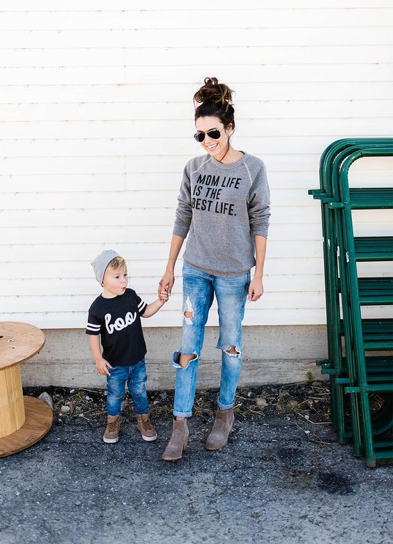 ripped denim, printed shirts and neutral boots and sneakers