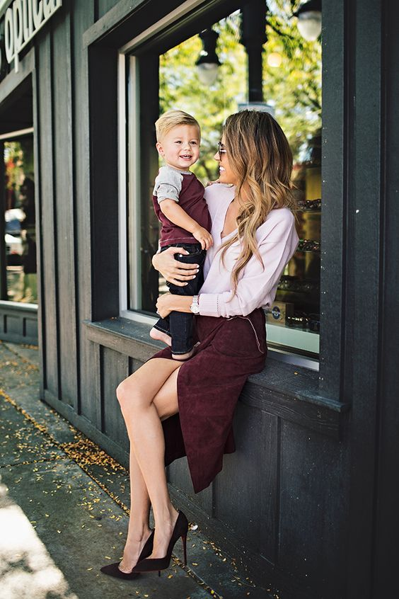 a burgundy tee and dark denim for the boy, a burgundy skirt and a blush shirt and suede shoes for the mom