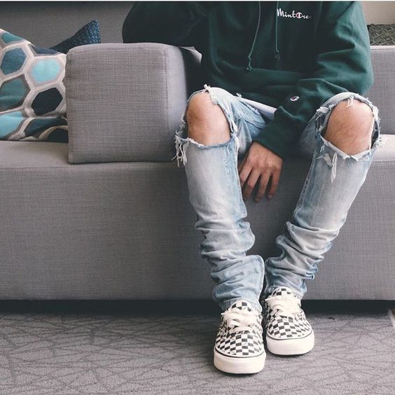 ripped denim, a green sweatshirt and checked Vans