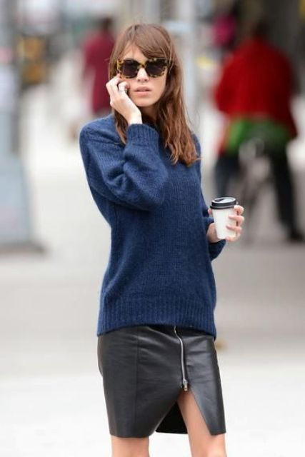 With navy blue sweater and printed sunglasses