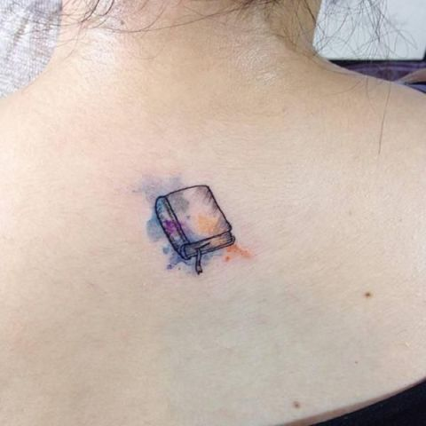 Watercolor book tattoo on the back
