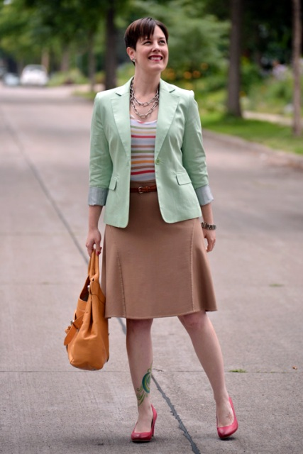 With striped shirt, camel skirt and red shoes