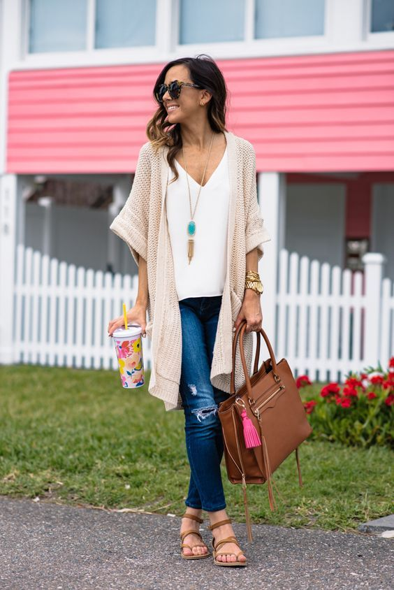 a white top, a neutral crochet cardigan, ripped jeans and brown sandals