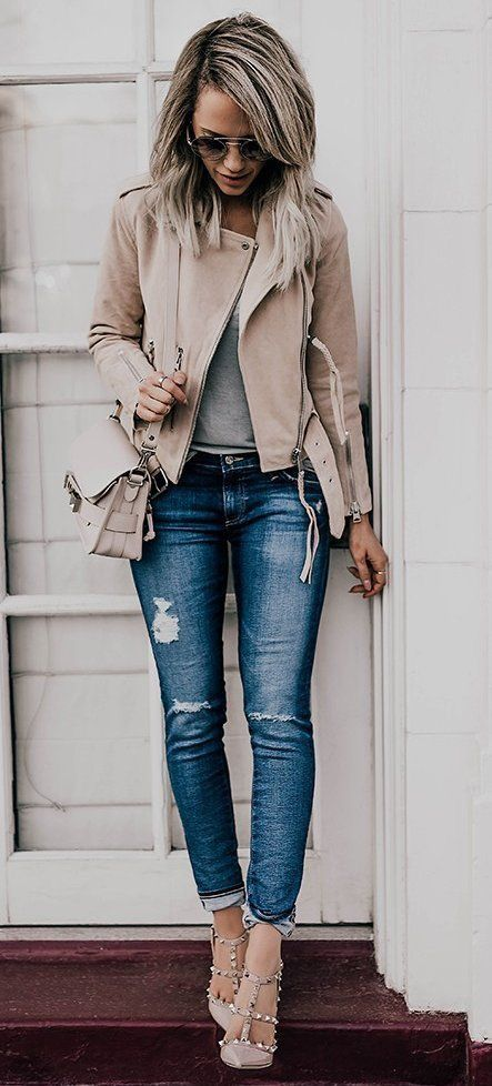 grey-nude leather jacket with distressed jeans, grey studded heels and a grey shirt