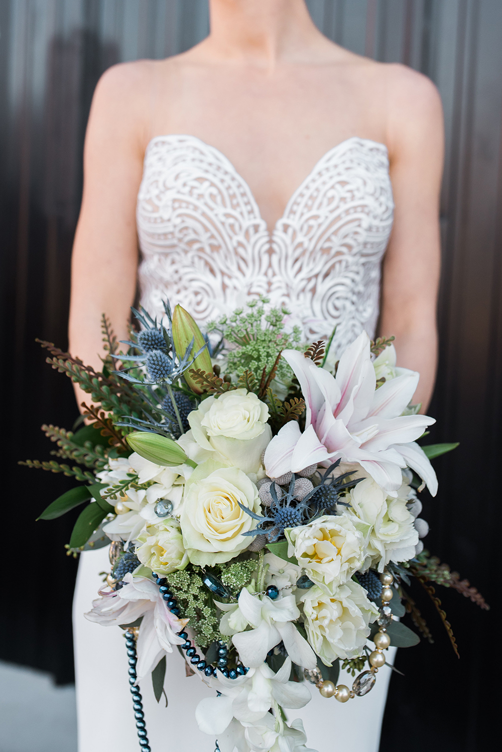 bridal bouquet with lilies and blue flowers - photo by Holly von Lanken http://ruffledblog.com/elegant-parisian-inspired-wedding-ideas