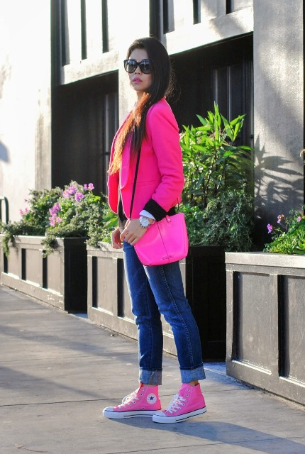 With jeans, pink and white converse and pink bag