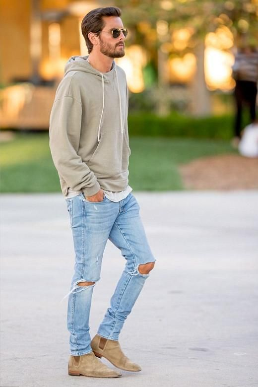 ripped blue jeans, a grey hoodie and beige suede boots