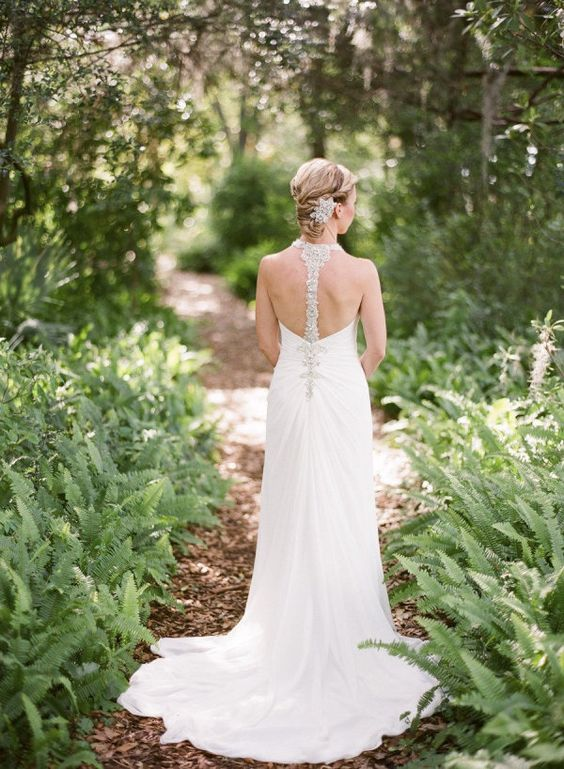 elegant wedding dress with a train and a jeweled racerback
