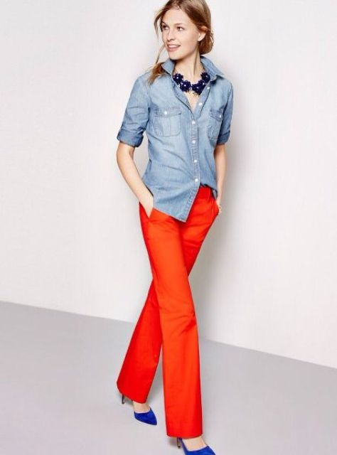 With denim shirt, statement necklace and blue shoes