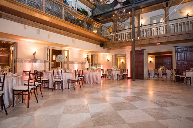 Bistro lights indoor wedding reception | Starfish Studios