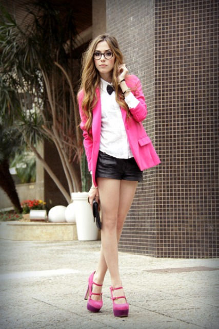 With white button down shirt, black leather shorts and platform shoes