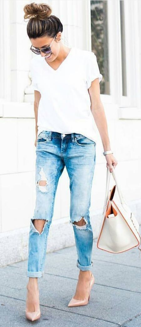 ripped blue jeans, a white tee and blush heels