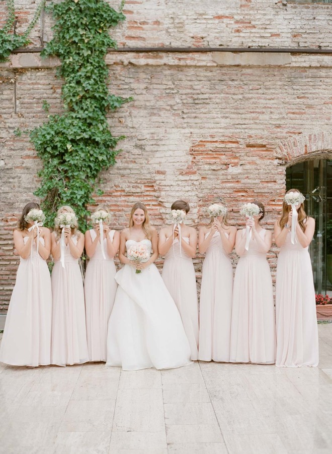 The bride was wearing a strapless dress with wrap skirt detailing and her bridesmaids were rocking blush gowns