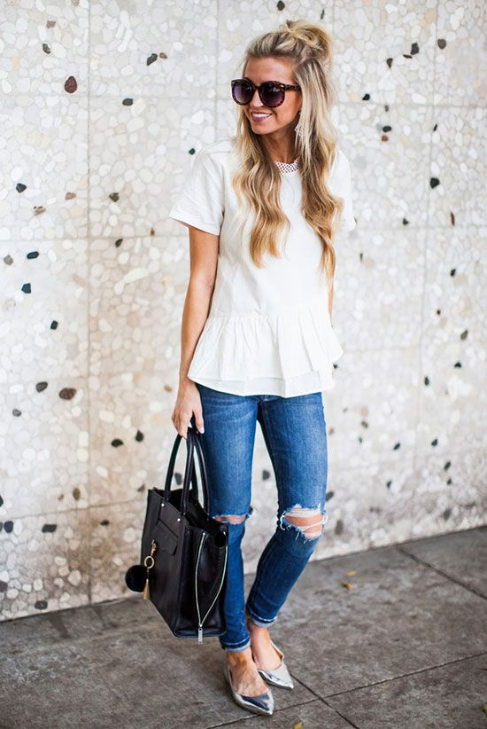 white flare shirt, ripped blue jeans, silver flats and a black tote
