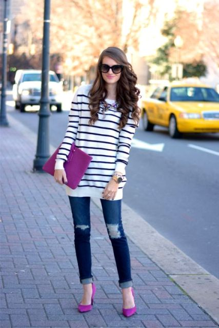 With striped loose sweater, distressed jeans and pink clutch