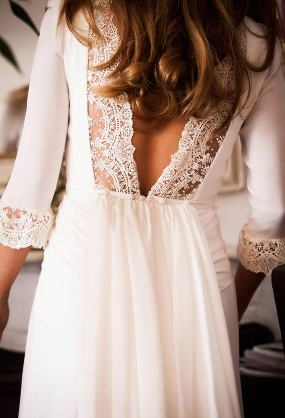 plain wedding dress with half sleeves and a V cut back decorated with lace