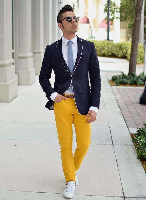 With white shirt, gray tie, navy blue blazer and white sneakers
