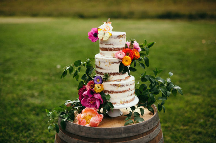 The cake was a naked one and topped with fresh flowers and leaves