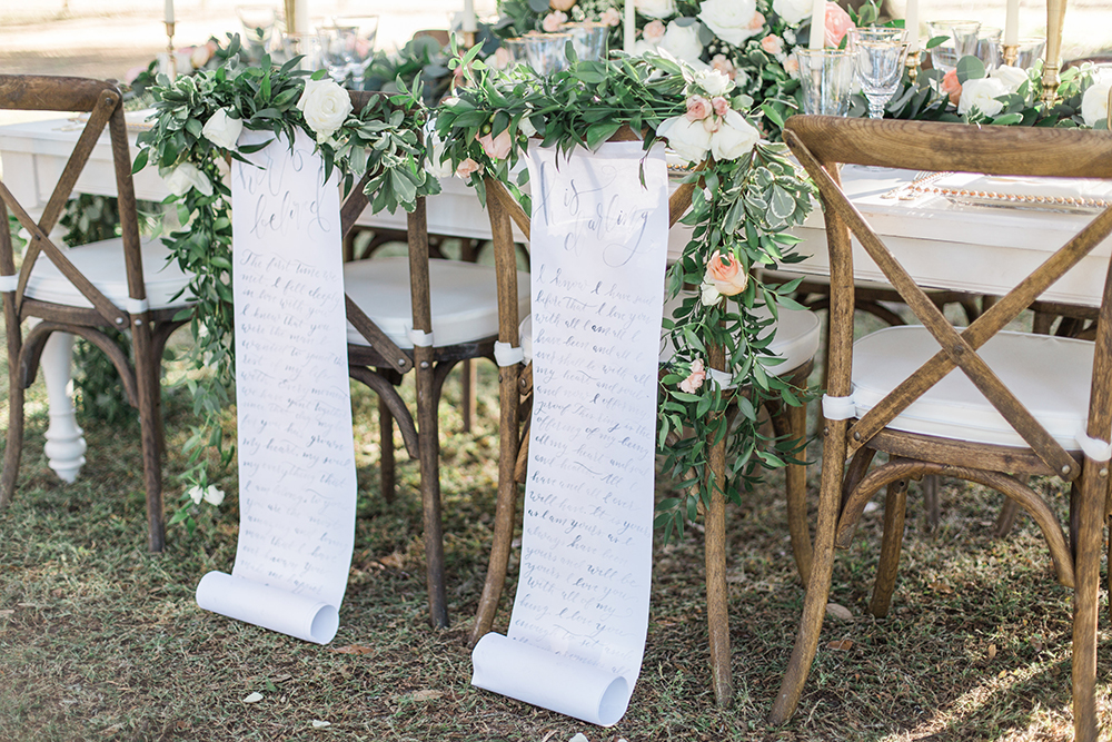 wedding chair decor - photo by Landon Hendrick Photography http://ruffledblog.com/southern-garden-chic-wedding-inspiration