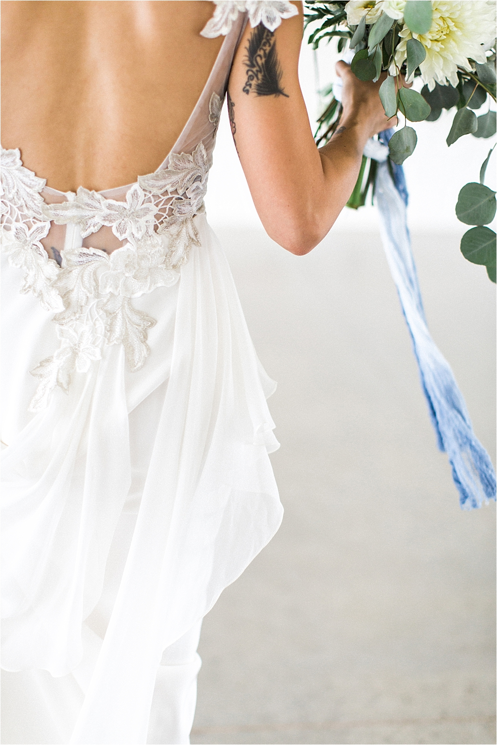 unique lace wedding dresses - photo by Flora and Fauna http://ruffledblog.com/modern-bohemian-wedding-with-an-air-plant-bouquet