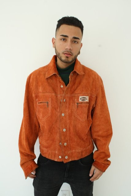 Orange jacket with green shirt and jeans