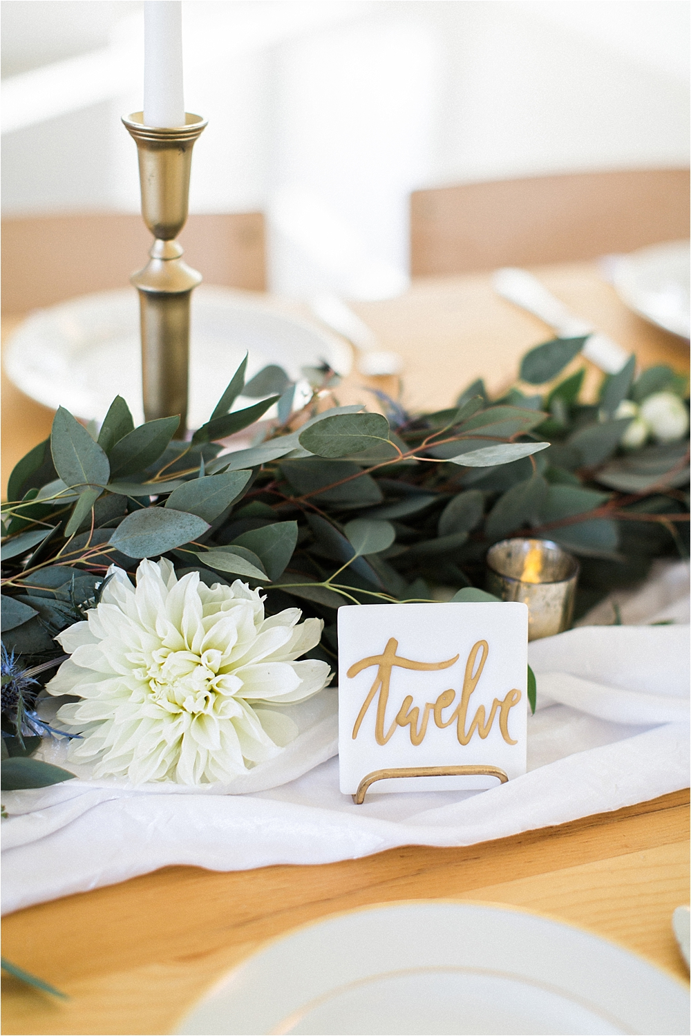table numbers - photo by Flora and Fauna http://ruffledblog.com/modern-bohemian-wedding-with-an-air-plant-bouquet