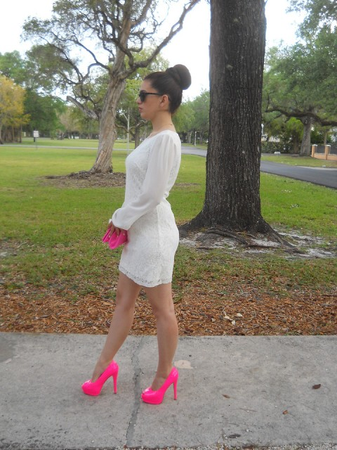 With white dress and pink clutch
