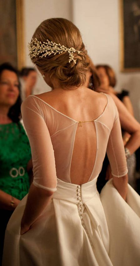 sheer cutout back wedding dress and a row of buttons
