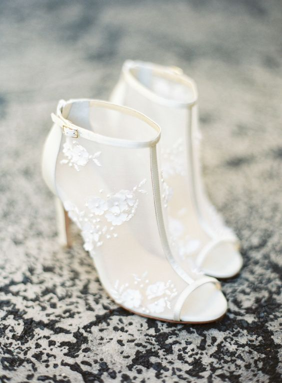 ivory sheer booties with peep toes and lace flower appliques