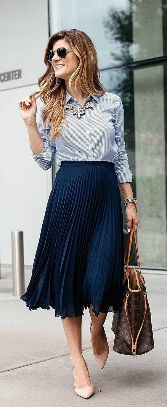 a navy midi pleated skirt, a thin striped shirt and blush flats