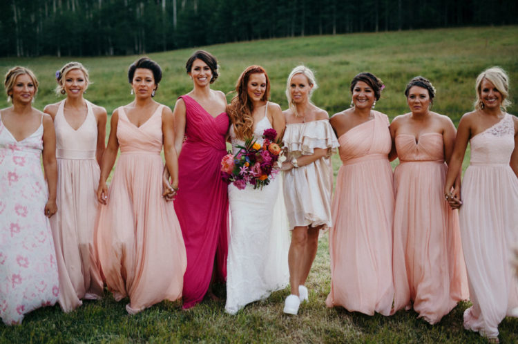 The bridesmaids were wearing mismatching dresses, blush, floral and neutral ones