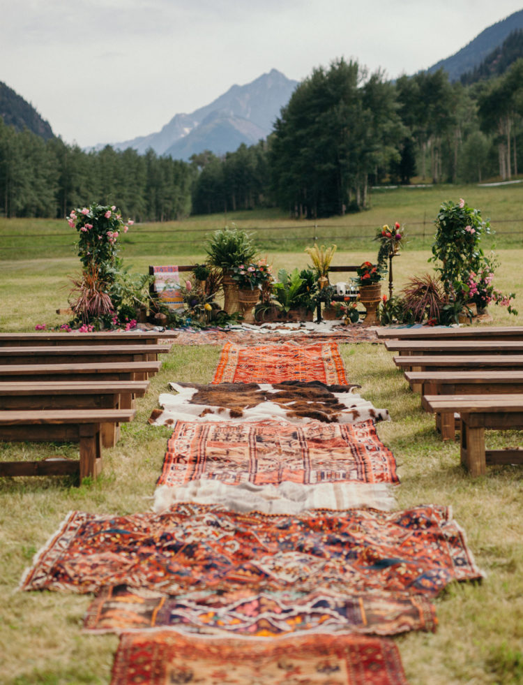 The ceremony spot was decorated with greenery and flowers and covered with rugs that bride had brought from her trips