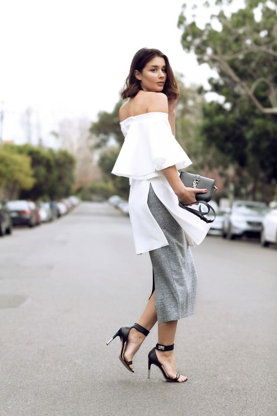 a grey midi skirt, a white off the shoulder tunic and black heels