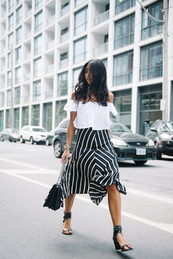 black and white striped skirt, a white off the shoulder, black heels