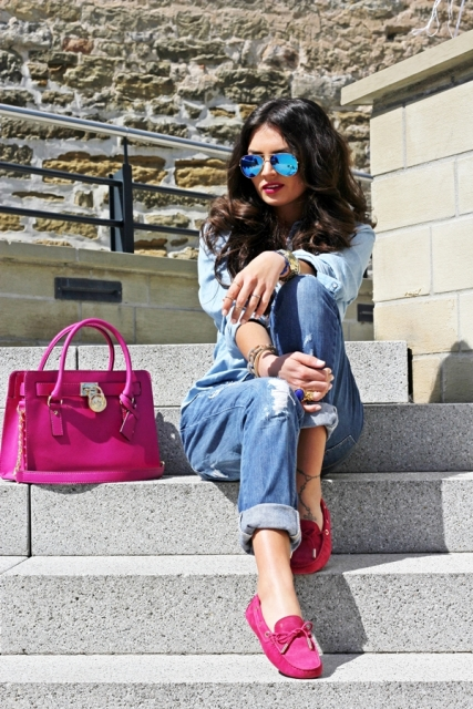 With denim shirt, cuffed jeans and fuchsia bag