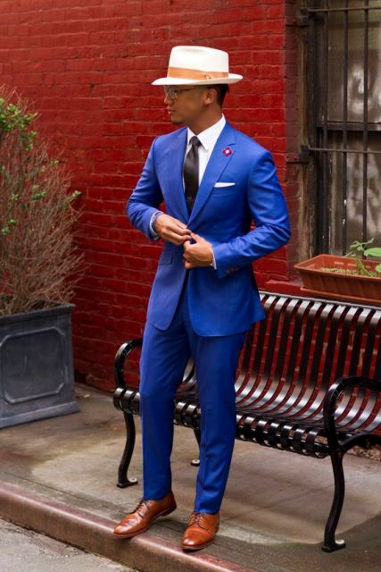 With white shirt, pastel color hat and blue blazer