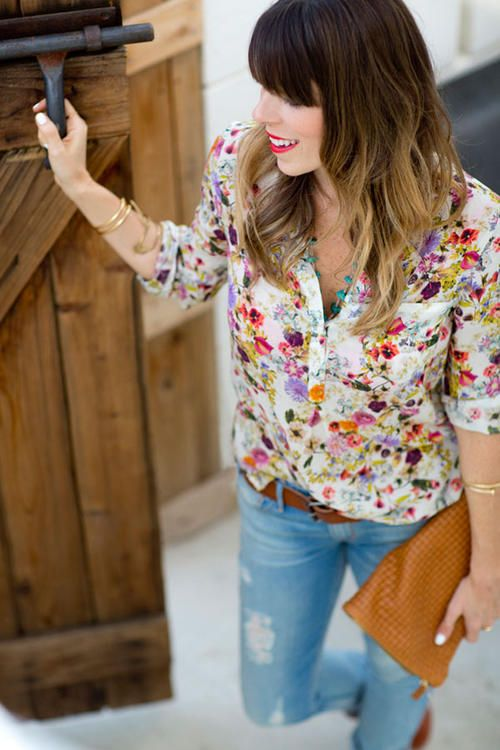 a bold floral blouse, ripped skinnies and a brown belt