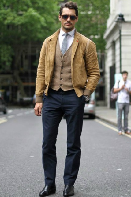 With beige vest, white shirt, gray tie and dark gray pants