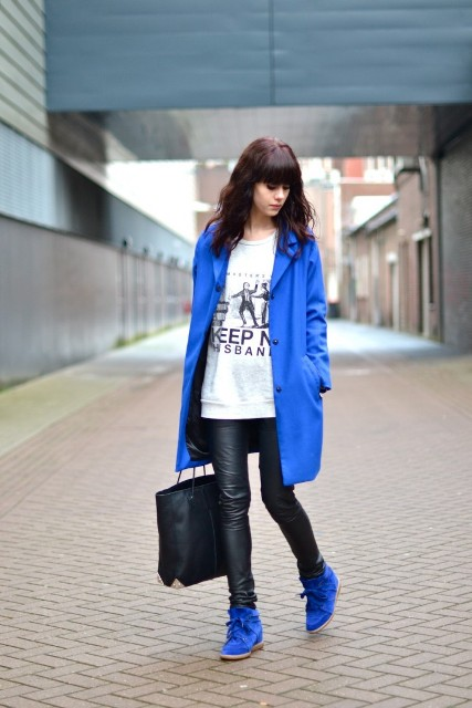 With blue trench coat, long shirt and skinny leather pants
