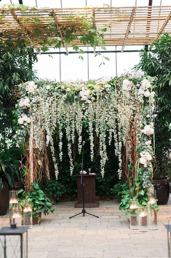 lush greenery and flower wedding arch with hanging flowers can easily fit lots of styles