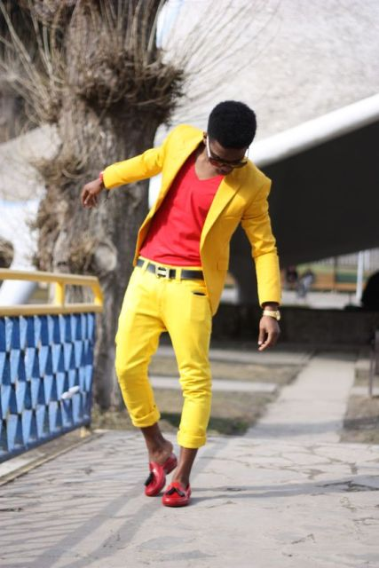 With red shirt, yellow blazer and red shoes