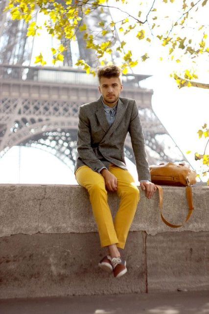 With striped shirt, gray blazer and brown bag