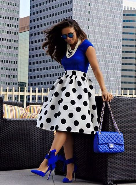 With blue shirt, polka dot skirt and necklace