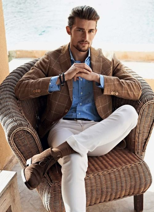 brown windowpane jacket, a polka dot blue shirt, white pants and brown suede shoes