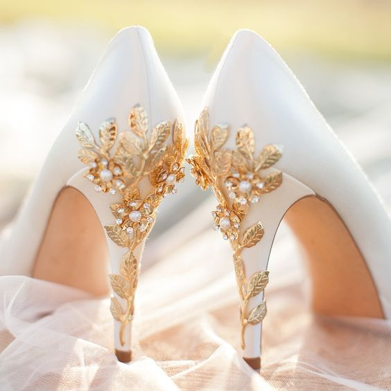 white platform shoes with gold cherry blossoms and pearls look luxurious