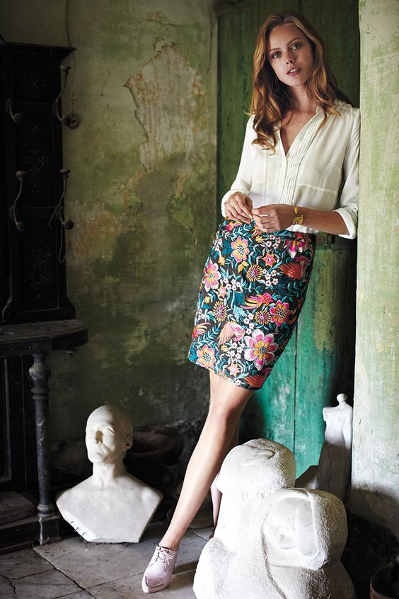 an ivory v-neck blouse, a floral over the knee skirt and blush shoes