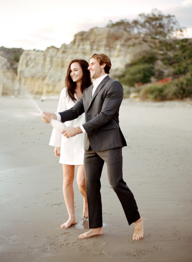 Champagne toast on beach | Lacie Hansen Photography