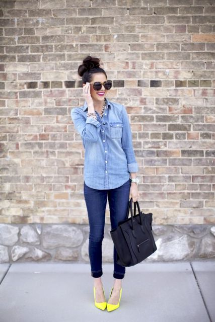 With denim shirt, crop jeans and black bag