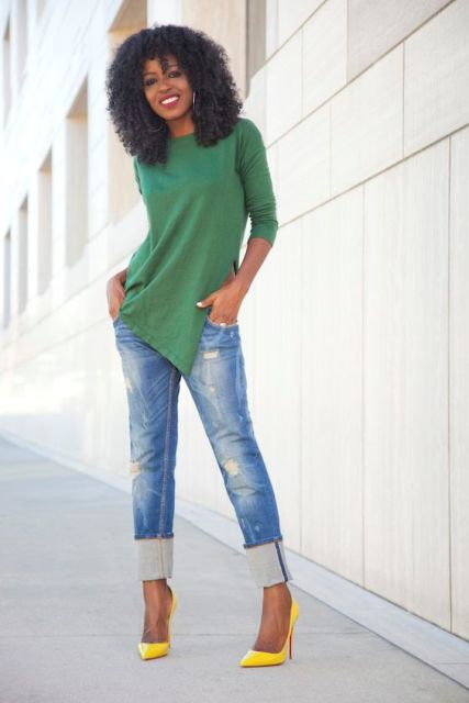 With green shirt and cuffed jeans